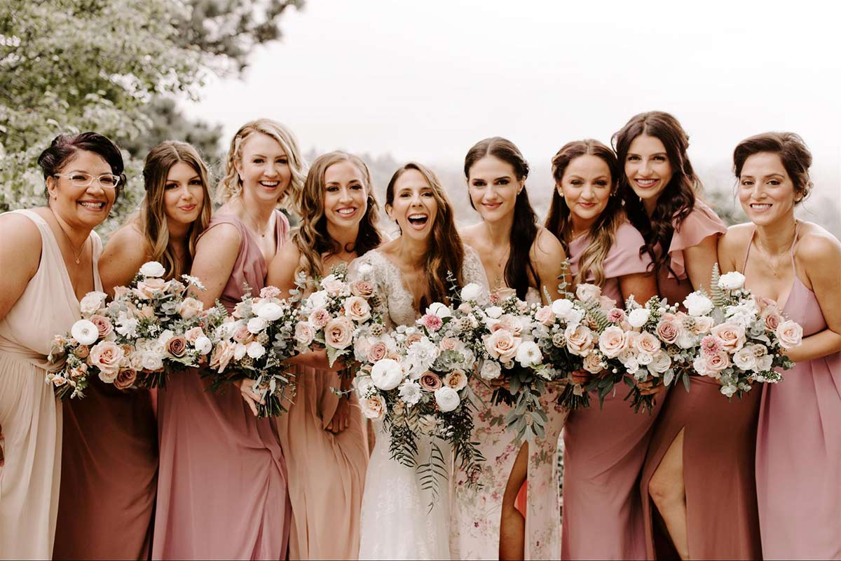 Dessy Real Wedding - Mix and Match Pink Bridesmaids - @theshepardsphoto