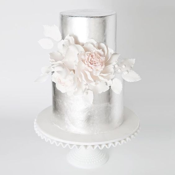 metallic silver wedding cake with edible cream flowers