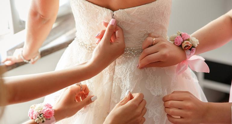 getting bride ready zipping dress