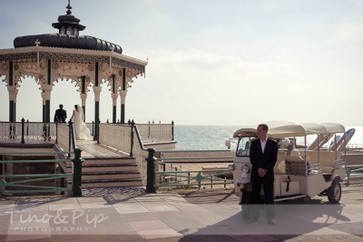 bride and groom on seaside promenade