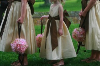 bridesmaids with pink silk hydrangea pompoms