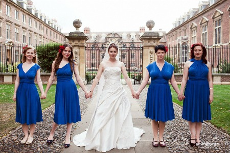 bridesmaids in blue convertible dresses at wedding