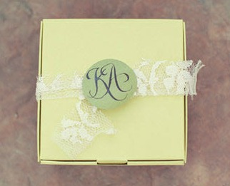 green favour box tied with lace
