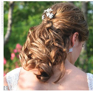 brides hair with diamante clip and curls
