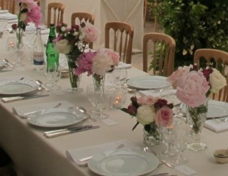 pink roses decorating reception table