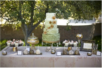 dessert table with green tier cake