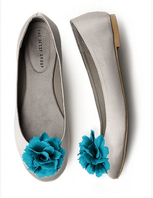 White ballet flats with blue rosettes