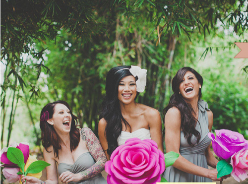 bridesmaids with giant paper flowers