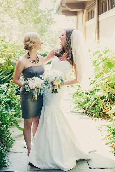 bride and bridesmaid in gray