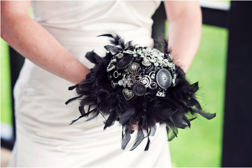 button bouquet with black feathers