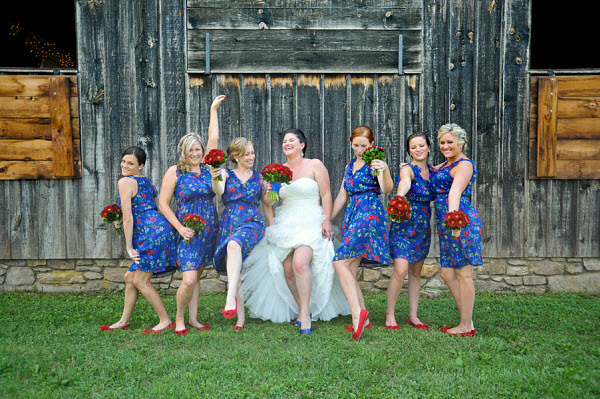 bride with bridesmaids in blue and red