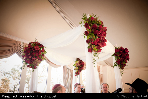 Jewish wedding chuppah with red roses