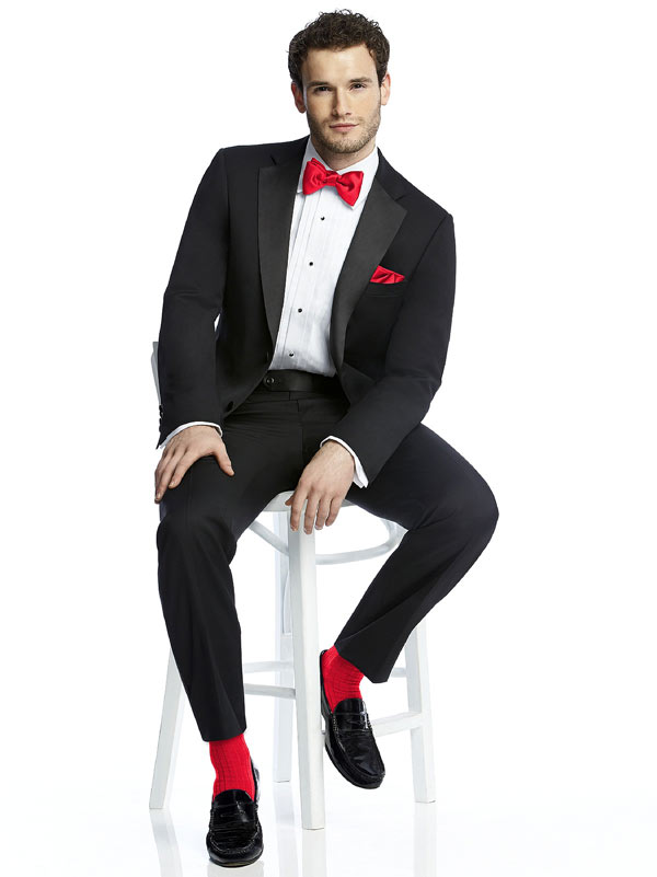 man in tuxedo with red tie and socks