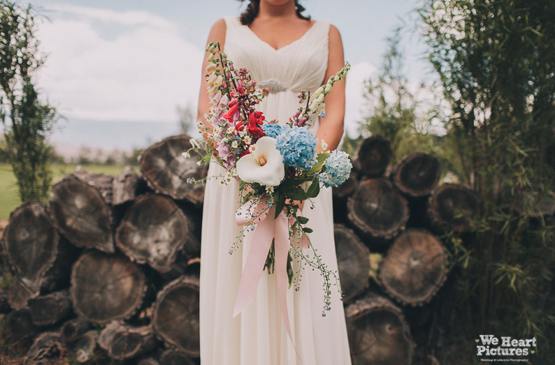 bride with countrystyle flowers