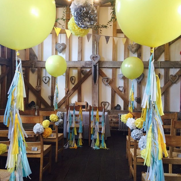 Yellow and blue wedding venue by Bubblegum Balloons